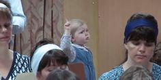WATCH: When This Precious Baby Girl Directs Choir, Things Get Real Serious