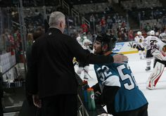 San Jose Sharks defenseman Matt Irwin gets a pat on the back from coach Larry Robinson (March 14, 2015).