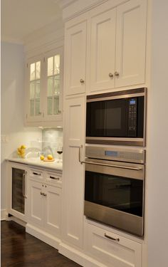 Kitchen Cabinet Ideas. Next to the the oven and microwave, a tall broom cabinet houses cleaning gear.