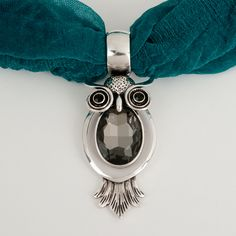 Owl Scarf Jewelry  12.90 at www.PurpleBoxJewelry.com Owls are a popular shape for fashion jewelry and finally we have the owl shaped scarf jewelry. The scarf jewelry pendant comes in two colors; black and topaz.