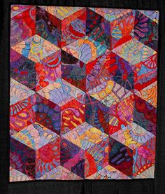 I don't usually like tumbling blocks very much - but this is great! Love the colors. This is very simple - but very dramatic.