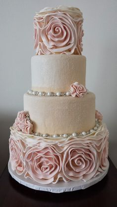 This is the cake that I want - The rosettes are a pink ombre. Best part - the middle layers are encrusted entirely in sanding sugar and dusted with edible glitter...