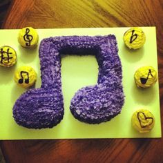 Music note shaped cake and music themed cupcakes. Done all by myself!!!! -Taylor Humphreys