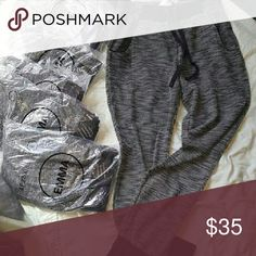 """🎉NEW Only Large Left Jogger sweat pants I do bundle  Offers welcome  No trades  No lowballing   New With Tags  Jogger sweat pants  Sizes available S M L Fabric 60% cotton 40% polyester Inseam is 30""""  Hip measurements laying flat across Small is 17""""  Medium 19""""  Large 21"""" EMMA Pants Track Pants & Joggers"""
