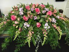 Sympathy casket spray by Hartman's Flowers