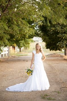 Love lace gown with Queen Anne neckline: Avenia Bridal