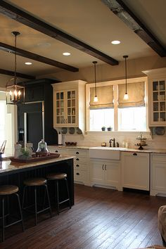 Dark floor? White cabinets. Love sink and upper cabinets with glass