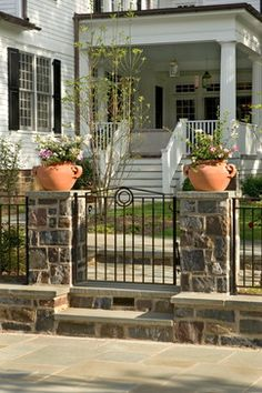 Front Yard Fences Design Ideas, Pictures, Remodel, and Decor - page 5 Note short, metal fence. Front Yard Fence, Pool Fence, Front Porch, Wrought Iron Fences, Metal Fence, Beautiful Home Designs, Beautiful Homes, Stone Pillars, Traditional Landscape