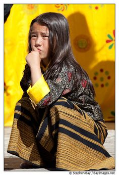 Bhutan / Young girl wearing a kira at the Thimphu tsechu festival.