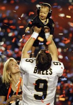 Such a precious moment of Drew Brees and his son after the Saints won the Super Bowl.
