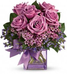 The Morning Melody bouquet is a mix of classic and modern, and is sure to make someone's day. Created with lavender roses and waxflower, purple limonium and greens. Order online or visit us in Westerly, RI. http://www.westerlyriflowers.com/westerly-flowers/telefloras-morning-melody-372762p.asp?rcid=105200&point=1