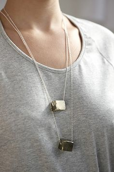 pyrite (fools gold) cubes on silver chains.