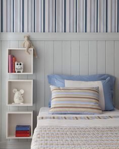 Love this wall paper coupled with wall panelling