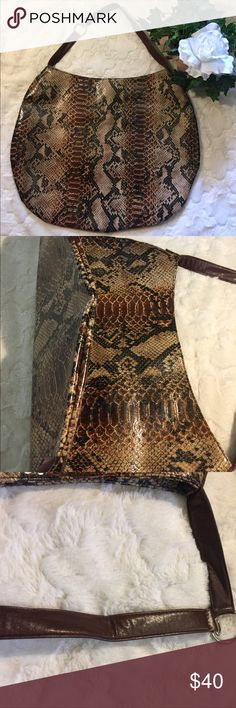 NWOT Glossy Snake Print Brown/Black Hobo Bag New without tags. No rips, tears or stains. Beautiful glossy vegan leather. Cream, light & dark brown and black snake print. This baby is huge! Lotsa room on the inside. 20' across. 15 1/2' height. No depth. Bag is flat. See pic. 2 ft drop. No inside pockets. No zipper. 1 snap closure. Bags Hobos