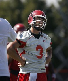 Utah QB Jordan Wynn turns to look at Offensive Coordinator Brian Johnson after hitting a deep receiver during the opening day of Utah football training camp, Thursday, August 2, 2012. (Scott Sommerdorf     The Salt Lake Tribune)