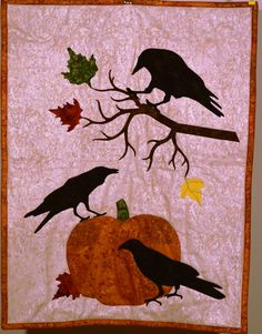 Autumn Crows with Pumpkin. Fall Wallhanging using my Silhouette Cameo cutter.I can make a Custom Keepsake quilt for you.   Email to DebbieLangeQuilting@gmail.com. www.DebbieLangeQuilting.blogspot.com. Facebook: Debbie Lange Quilting. Pinterest: Debbie Lange Quilting.