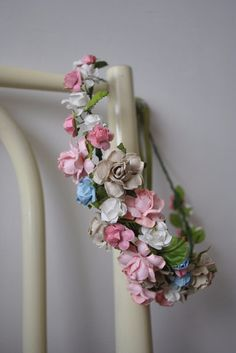 Hand-made flower crown. The crown is open-ended and can be tied on the back with a ribbon.  Materials: florist wire, floral tape, paper flowers.  This item is ready to be shipped!