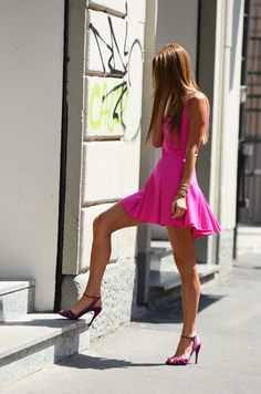 Street style long legs in a short pink dress and ankle strap high heels