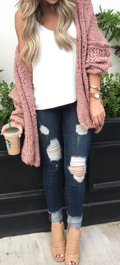 women's pink knit cardigan, white top, blue distressed skinny jeans, and brown peep-toe heeled bootie