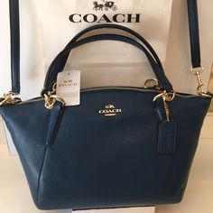 COACH NEW HANDLE/CROSSBODY BAG 100% AUTHENTIC COACH NEW NEVER USED WITH TAGS BLUE PEBBLE LEATHER HANDLE/ CROSSBODY BAG. AMAZINGLY BEAUTIFUL BAG NEW THAT OS PERFECT FOR ANY OCCASION. IT CAN BE USED AS EITHER A HANDLE BAG OR A CROSSBODY BAG. THE BAG MEASURES 13 INCHES WIDE BY 9 INCHES TALL. THE HANDLE STAP IS A 5. INCH DROP AND IT ALSO COMES WITH A REMOVABLE LONG CROSSBODY STRAP Coach Bags Shoulder Bags