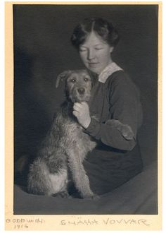 "Henry B. Goodwin Photography Goodwin's darkroom assistant Elisabeth Lundquist, with the Airedale ""Troll""  c. 1916     Gelatin silver print  11.0 x 16.0 cm     Private collection of Björn Andersson    LL/31824     Signed ""Goodwin. Snõlla vovvar""."