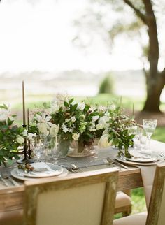 Overflowing compotes contrast nicely with barely-there, thin candlesticks on this wedding tablescape that's akin to a breath of fresh summer air.  Via Bellafare
