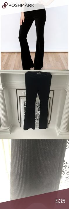 """Free People Velvet Cord Baby Bell Flare Pants XS Black XS worn twice. They are like the pull on kick flares with the elastic waist. Still have original tags. They are a velvet stretch material with a corduroy stripe to them. Sorry the are hard to photograph. Waist 13"""" flat in stretched rise 9"""" inseam 34"""" 56% cotton 39% polyester 6% spandex machine wash Free People Pants Boot Cut & Flare"""