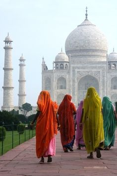 Women in colorful saris walking towards the Taj Mahal, Agra, Uttar Pradesh, India