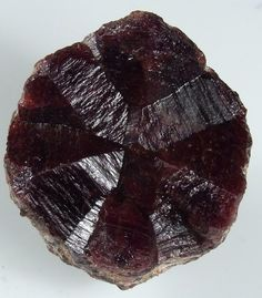 Russ Behnke Drill bit twin of garnet. My twin is from Merelani, Tanzania and measures 1.6 inches across. No others have been found. A full report on this twin shall appear in Mineral News.