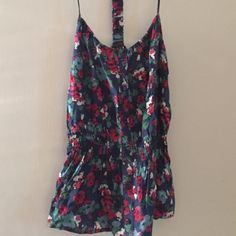Forever 21, colorful floral tank top Forever 21 colorful floral tank top. Interesting back strap detail. Barely worn, great condition. Size small. No trades, sorry. Please inquiry before bundling this item. It's at my moms  Forever 21 Tops Tank Tops