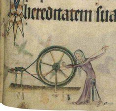 Woman spinning on the great or walking wheel.