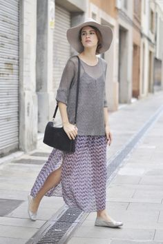 slip dress with sheer sweater layerd over.