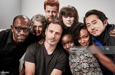 Actors Lennie James, Melissa McBride, Andrew Lincoln, Michael Cudlitz, Chandler Riggs, Danai Gurira, Sonequa Martin-Green, and Steven Yeun of 'The Walking Dead' pose for a portrait at the Getty Images Portrait Studio Powered By Samsung Galaxy At Comic-Con International 2015 at Hard Rock Hotel San Diego on July 11, 2015 in San Diego, California.