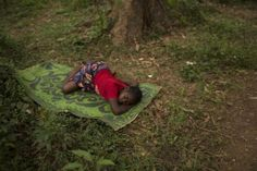 A woman sleeps on a mat on the ground in the RDOT camp in Kilometre 11 (PK11), where some of the last remaining Seleka fighters are sheltering, guarded by African Union and French peacekeeping forces in the capital Bangui March 14, 2014. REUTERS/Siegfried Modola