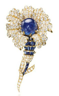 A SAPPHIRE AND DIAMOND BROOCH, BY VAN CLEEF & ARPELS -