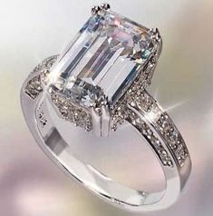 Diamond Rings This ring is absolutely gorgeous! STACY loves Emerald Cut Diamond rings for possible wedding ring. Emerald Cut Rings, Emerald Cut Diamonds, Diamond Cuts, Ruby Rings, Raw Emerald, Pink Diamonds, Emerald Stone, Emerald Green, Jewelry Rings