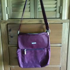 Baggalini Crossbody Bag - Vegan Bright Plum nylon bag is loaded with pockets, pockets, and more pockets.  Perfect for travel, shopping, etc.  Long, adjustable shoulder strap. Never used.   TRADES PP LOW-BALL OFFERS Baggalini  Bags Crossbody Bags