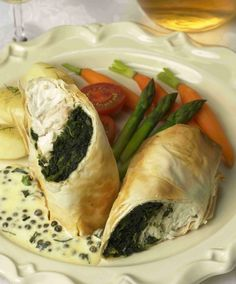 Halibut and Garlic Spinach Wrapped in Phyllo w/ a Lemon Garlic Caper & Chive Cream Sauce- use a dill tartar sauce instead fish vegetable main Best Halibut Recipes, Best Fish Recipes, Seafood Recipes, Sauce Recipes, Cook Fresh Spinach, Garlic Spinach, Spinach Wrap, Filo Recipe, Lemon Caper Sauce