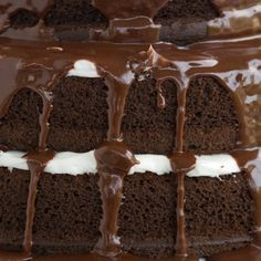Here is a chocolate cake recipe that gives you a three layer cake with marshmallow filling and a milk chocolate ganache drizzled over the top while it is still warm.