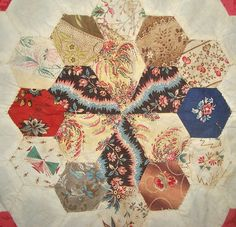 Hexagons with beautiful fabric These look to be abt. 1820-30