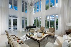 Modern sun filled waterfront corner townhouse by award winning architect Suzanne Martinson. 5349 sf w/ private dock, 22 ft ceilings, sky & water views, 5 bed, 5.5 bath, custom eat-in kitchen, 2 car garage, rooftop deck, summer kitchen, large open floor plan. 1st time on the market, the premier TH - The Jewel in the Crown. For more information about this property see link below:  http://search.nancybatchelor.com/idx/details/listing/a016/A1791137/217-ZOE-WY-0-Miami-Beach-A1791137#.Uo5tvY2E6wF
