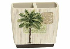 Add a tropical touch to your bathroom with a 100% resin toothbrush holder that has a Citrus Palm design.