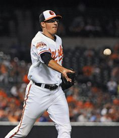 Orioles right-hander Kevin Gausman flips the ball to first base to retire the Los Angeles Angels' Howie Kendrick in the seventh inning at Camden Yards.