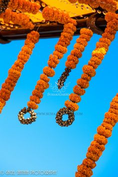 Wedding mandap, Marigold Garlands, brass bells, bamboo sticks