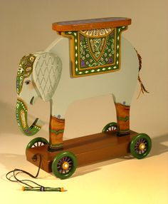 """I made these pull toys to go with my Circus Collection of artwork.  The elephant is 18"""" high.  A labor of love"""