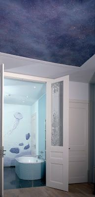Trompe l'oeil murals and astarry night sky painted ceiling in master bedroomand bathroom