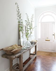 Console Flooring Collected rustic accessories in contrast to a more traditional space