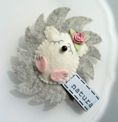 Felt Hedgie with rose adornment.