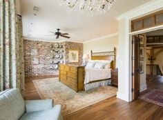 We love the brick wall in this bedroom at 44 River Marsh Lane on #Kiawah Island (available for sale as of 07.28.16) #LuxuryRealEstate