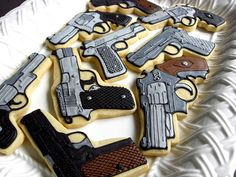Shooting Range cookies-- finally got my first pistol. Fancy Cookies, Cut Out Cookies, Cute Cookies, Cupcake Cookies, Sugar Cookies, Cop Party, Gun Cakes, Cookie Designs, Cookie Ideas
